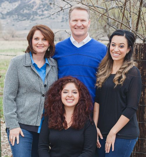 Garth Smith with his wife Diane, and daughters Megan and Susana